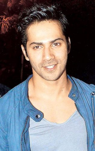 Varun Dhawan Chest Biceps size