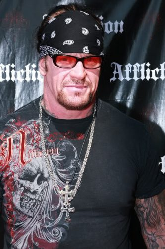 The Undertaker Chest Biceps size